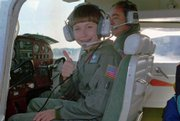 Vicki Van Meter is shown at age 11as she leaves on the first leg of a cross-country flight in this Sept. 20, 1993, file photo. Accompanying her is flight instructor Bob Baumgartner.