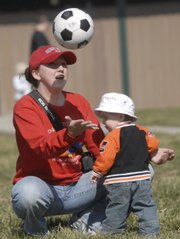 Tami Zimmerman, Lawrence, plays with her son Madox, 1, at Holcom Park, Wednesday, March 19, 2008. Zimmerman and her son were enjoying the spring like weather with her husband Matt and their older son Peyton, 3. The Zimmerman's moved to Lawrence four years ago. The latest Census Bureau numbers for Douglas County show the community population is doing little more than keeping pace with the statewide average.