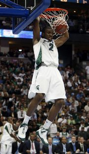 Michigan State forward Raymar Morgan dunks the ball for a basket against Temple in the second half of Michigan State's 72-61 victory in a first-round NCAA South Regional basketball game in Denver, on Thursday, March 20, 2008.