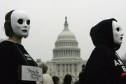 Masked protesters line up before the U.S. Capitol in a rally against the war in Iraq. Anti-war protests took place across the nation Wednesday on the fifth anniversary of the U.S.-led invasion.