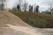 Residents watch water seep through recently placed gravel against a levee on the Black River in Poplar Bluff, Mo. Much of Missouri is threatened with flooding after a slow-moving storm system dumped up to a foot of rain in the nation's midsection.