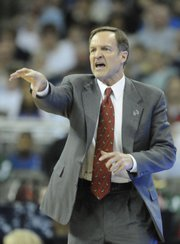 UNLV coach Lon Kruger yells at his defense during the second half against Kent State. The Rebels rolled to a 71-58 first-round victory Thursday in Omaha, Neb.