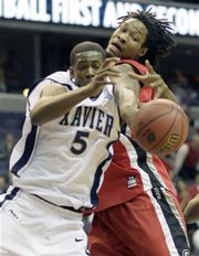 Xavier forward Derrick Brown (5) battles with Georgia's Albert Jackson during first half action of the first round of a NCAA men's west regional basketball game Thursday March 20, 2008 in Washington.