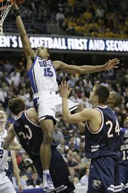 Duke guard Gerald Henderson shoots past Belmont's Matthew Dotson (30) and Justin Hare (24) and scores giving Duke a 71-70 victory in a first round NCAA West Regional basketball game, Thursday March 20, 2008, in Washington.