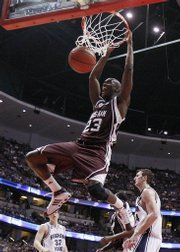 Texas A&M's Josh Carter dunks against Brigham Young during the second half of a first-round game at the NCAA men's basketball tournament West Regional on Thursday, March 20, 2008, in Anaheim, Calif. Carter finished with 26 points as Texas A&M won 67-62.