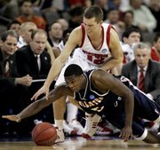 Wisconsin guard Jason Bohannon (12) and Cal State Fullerton guard Frank Robinson battle for a ball during the first round of the NCAA Midwest Regional basketball game in Omaha, Neb., Thursday, March 20, 2008. Robinson picked up his fifth foul on the play and was out of the game.