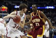 Winthrop forward Taj McCullough, right, comes in to cover Washington State forward Robbie Cowgill as he pulls down a rebound in the second half of a first-round NCAA East Regional basketball game in Denver on Thursday, March 20, 2008. Washington State defeated Winthrop 71-40.