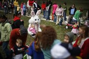 Parents and children visit the Easter Bunny on Saturday during the Egg Hunt Eggstravaganza at South Park.