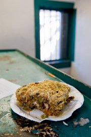 Nutraloaf, a product from the cafeteria of the Chittenden Regional Correctional Facility, sits atop an inmate's bunk bed Friday in South Burlington, Vt. Nutraloaf is made of whole wheat bread, nondairy cheese, raw carrots, spinach, seedless raisins, beans, vegetable oil, tomato paste, powdered milk and dehydrated potato flakes.