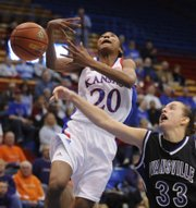 Kansas guard Sade Morris gets the ball knocked away by Evansville's Rebekah Parker in the first half. Morris tallied 16 points in the Jayhawks' 82-60 win on Monday in Allen Fieldhouse during the second round of the WNIT.