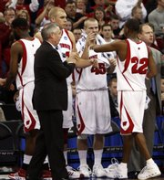 IN: Wisconsin Badgers Head Coach Bo Ryan applauds as Wisconsin guard Michael Flowers (22) congratulates Wisconsin center Greg Stiemsma (34) and Wisconsin guard Joe Krabbenhoft (45) after the Badgers beat Kansas State 72-55 win a second round of a NCAA Midwest Regional basketball game in Omaha, Neb., Saturday, March 22, 2008.
