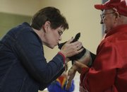 Nancy DeGarmo, New York School principal, made good on a bet with students on Tuesday. She was one of five staff members collecting money for a school bowling trip, and the winner had to kiss a pig. DeGarmo raised about $200. Kirby Anders, of Eudora, brought the pig for DeGarmo to kiss.