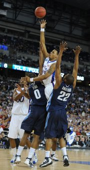 Kansas guard Brandon Rush flies in for a floater over Villanova defenders Antonio Pena and Dwayne Anderson during the first half Thursday, March 28, 2008 at Ford Field in Detroit.