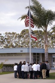 Students gather around a makeshift memorial Feb. 14 at E.O. Green Middle School, honoring slain student Lawrence King, 15, who was killed by a classmate in Oxnard, Calif., allegedly because he was gay. The slaying of King has alarmed gay rights activists and led to demands that middle schools do more to educate youngsters about discrimination on the basis of sexual orientation.