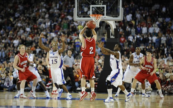 Kansas' Mario Chalmers (15) and Sherron Collins rush to defend Davidson's Jason Richards, who missed the potentially game winning shot, on Sunday, March 30, 2008 in Detroit, Mich.