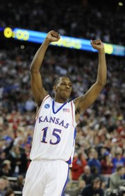 Kansas guard Mario Chalmers throws his fists in the air after the Jayhawks clinched a Final Four berth with a victory over Davidson in the Midwest Regional Final on Sunday in Detroit.