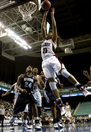 Connecticut forward Maya Moore (23) goes up for a basket.