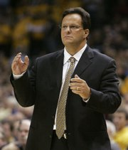 Marquette coach tom Crean watches his team during a December game against Coppin State. Indiana hired Crean on Tuesday as its new coach.