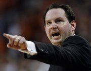 Sean Sutton shouts instructions to his Oklahoma State team in this file photo from OSU's game against Texas on March 9 in Austin, Texas. Sutton resigned under pressure Tuesday.