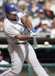 Kansas City's Jose Guillen singles and drives in a run against the Tigers. K.C. won, 4-1, Thursday in Detroit.