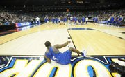 Kansas guard Rodrick Stewart calls attention to his right knee as he lays on the baseline Friday, April 4, 2008 at the Alamo Dome in San Antonio.