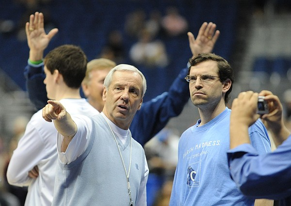 North Carolina coach Roy Williams, left, talks with assistant C.B. McGrath during the start of of the Tar Heels' public practice.