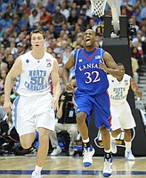 Kansas forward Darnell Jackson roars as he trots back on defense following a bucket in the second half Saturday, April 5, 2008 at the Alamodome in San Antonio.