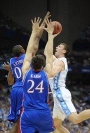 Kansas' Darrell Arthur blocks North Carolina's Tyler Hansbrough as Sasha Kaun bodies up in the first half on Saturday, April 5, 2008 at the Alamodome in San Antonio, Tx.