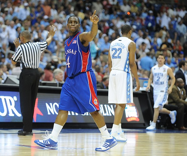 Kansas' Sherron Collins points to the fans as he exits the court against North Carolina in the first half on Saturday, April 5, 2008 at the Alamodome in San Antonio, Tx.