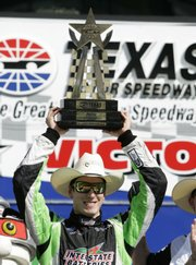 Driver Kyle Busch celebrates after winning the NASCAR Nationwide O'Reilly 300. Busch was victorious Saturday in Fort Worth, Texas.