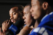 Kansas forward Darnell Jackson, left, peers down the table as he and his teammates sit for questions during an afternoon of interviews. The Jayhawks met the press Sunday, eve of tonight's NCAA national title game against Memphis at the Alamodome in San Antonio.