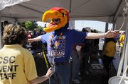 Jayhawk fan Doug Buck, from Wichita, is checked at security outside the Alamodome on Saturday, April 5, 2008 in San Antonio, Texas.