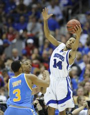 Memphis' Chris Douglas-Roberts skies for a rebound against UCLA in a national semifinal game Saturday.
