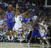 Kansas' Mario Chalmers drains a three against Memphis' Antonio Anderson on Monday, April 7, 2008 at the Alamodome in San Antonio, Texas.