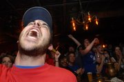 A Jayhawk fan breaks into a scream with other KU fans Monday, April 7, 2008 as KU wins the national championship while watching the game at the Jackpot Saloon.