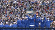 The Kansas men's basketball team, the NCAA 2008 national champions, waves to a crowd of more than 25,000 fans Tuesday at Memorial Stadium after returning to Lawrence from San Antonio.