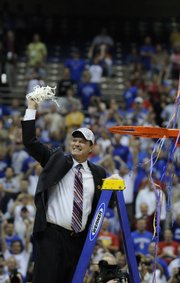 Kansas coach Bill Self pumps the net after the clipping ceremony. Self and the Jayhawks won the national title in his fifth year at KU.