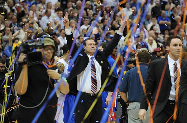 Kansas coach Bill Self raises his fists to the KU fans in the Alamodome.