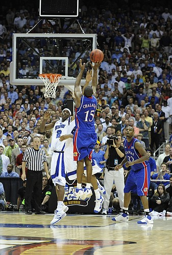 Kansas guard Mario Chalmers elevates for the three-pointer that put the game into overtime. Chalmers connected with 2.1 seconds left to tie it at 63, and the Jayhawks went on to win, 75-68 in overtime, April 7, 2008, in San Antonio.