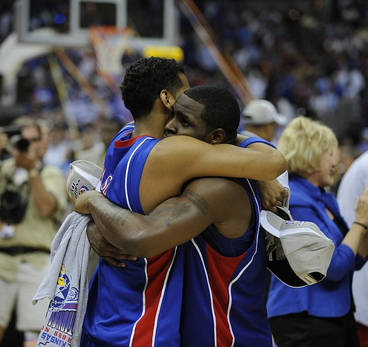 Kansas' Jeremy Case and Sherron Collins embrace after defeating Memphis on Monday, April 7, 2008 at the Alamodome in San Antonio, Texas.