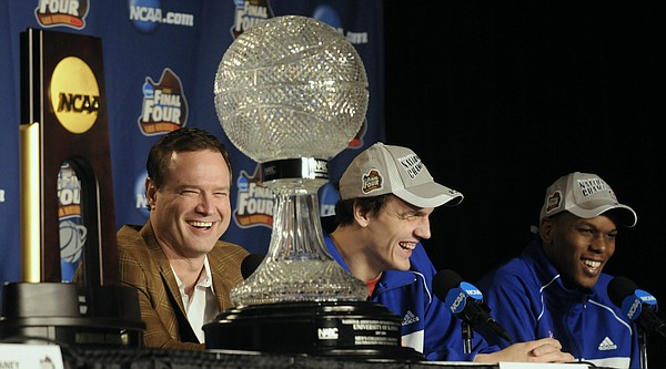 Flanked by their national championship trophies, Kansas coach Bill Self, left, Sasha Kaun, center, and Russell Robinson bask in the spotlight the morning after beating Memphis for the national championship in San Antonio.