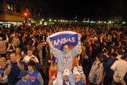 Fans celebrate on Mass. St. after the Jayhawks&#39; 75-68 overtime win over Memphis in the final game of the 2008 NCAA Men&#39;s Basketball championships.  KU&#39;s National Champion basketball team will be honored on Sunday at a 3 p.m. parade that will run along Massachusetts Street from Seventh Street to South Park.