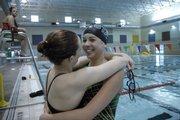 LHS swimmer Jessie Boyer, left, hugs FSHS swimmer Chloe Portela. Free State won its home quad on Senior Night on Tuesday at FSHS.
