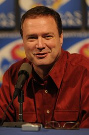 Kansas University basketball coach Bill Self, shown Thursday at a news conference at KU, has no plans to leave after winning the National Championship on Monday.