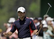 Trevor immelman reacts to a putt on the 17th green. Immelman fired a 68 during the second round of the Masters on Friday in Augusta, Ga.