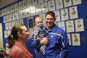 Katie Anderson, left, and her husband, Jack Anderson, meet cadets with their 6-month-old son, Lincoln, on Friday, April 11, 2008 during the Air Force ROTC Flying Jayhawk Wing Alumni Weekend cookout at the KU Military Science Building. Katie Anderson is a 2004 ROTC alumna.