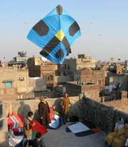 People fly kites to celebrate the spring festival, Basant, in a Feb. 9, 2003, file photo, in Lahore, Pakistan. Pakistan's cultural capital has lost another victim to the country's violence and political turmoil: a centuries-old festival that draws thousands who usher in spring by flying colorful kites.