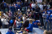 Fans raise their cameras for photographs of head coach Bill Self and his wife Cindy as they are driven down Massachusetts streets by Doug Compton during the Hawks&#39; celebration parade Sunday, April 13, 2008 in downtown Lawrence.