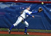 KU junior outfielder Dougie McCaulley just misses a line drive Sunday, April 13, 2008 during the Jayhawks' home softball game against Texas.