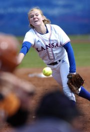 Kansas University's Valerie George delivers a pitch against Texas. The Jayhawks split a doubleheader with the Longhorns on Sunday at Arrocha Ballpark.